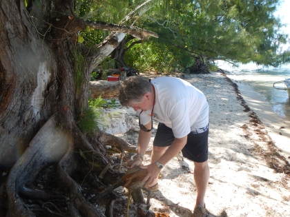 Jerry learning to husk a coconut
